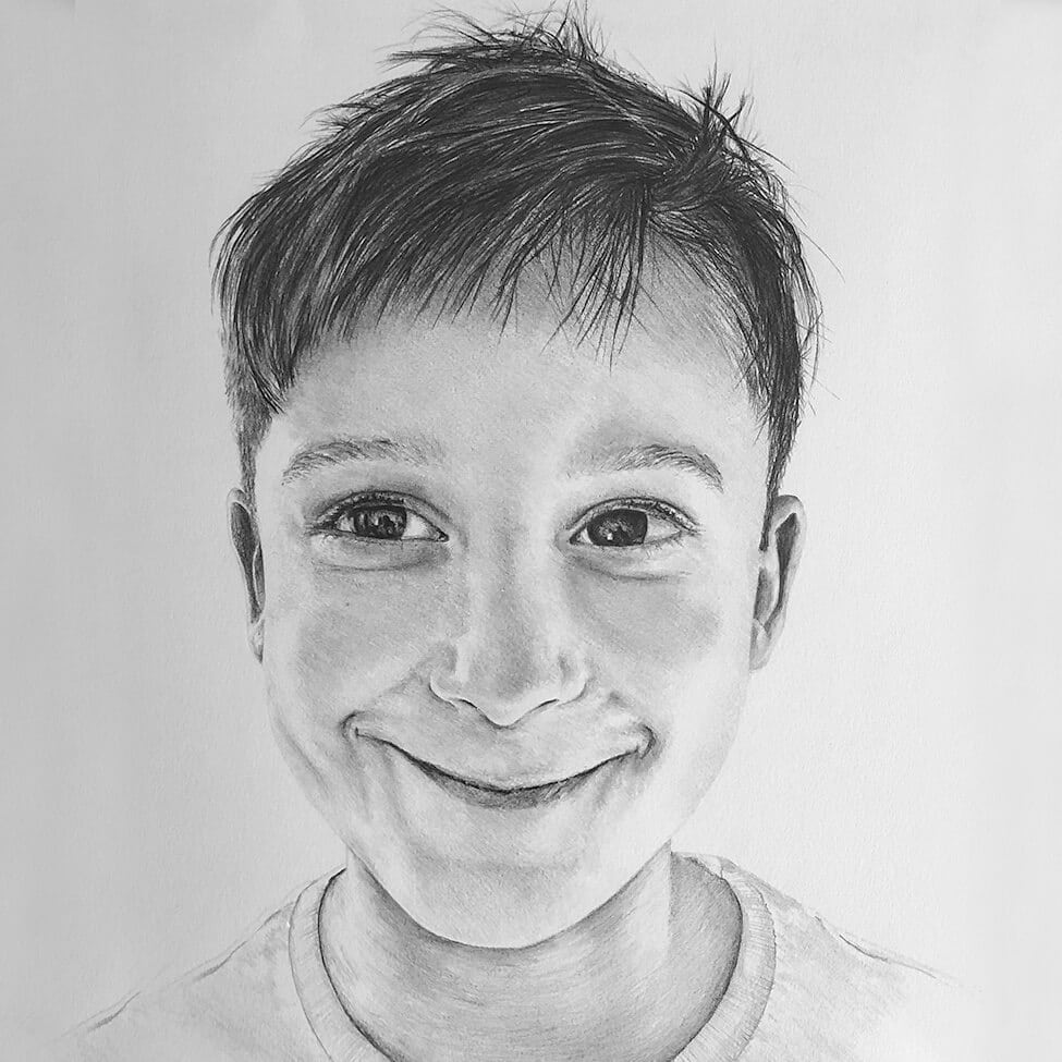 headshot of child portrait in black and white graphite pencil